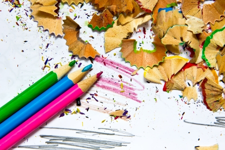 Pencil sharpener waste on a painted background photo