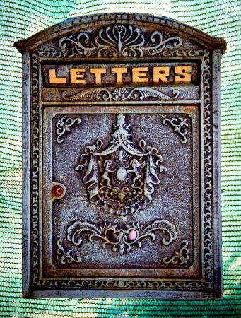 ancient mail box with the word letters photo