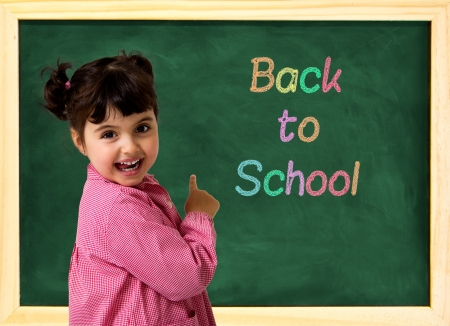 little school girl with green chalkboard and text photo