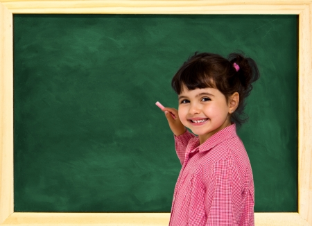 little school girl with green chalkboard photo