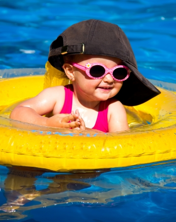 baby swimming in a pool with float