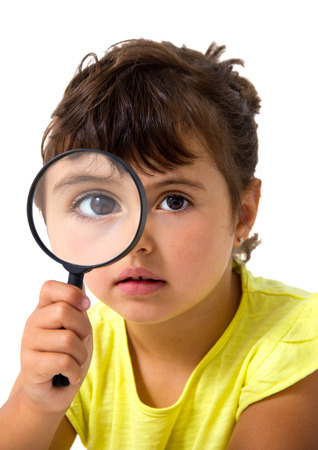 little girl with magnifier isolated on white photo