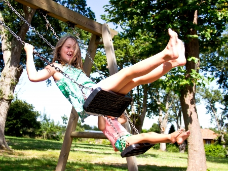 portrait of a girl on swing photo
