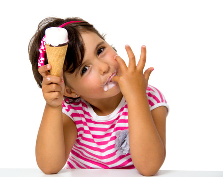face cream: little girl eating ice cream isolated on white Stock Photo