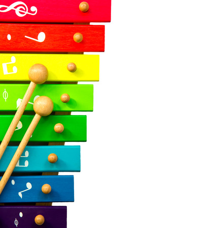 xylophone toy isolated on white photo