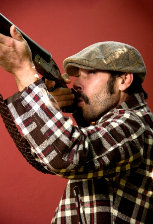 waistcoat: portrait of a hunter on a red background