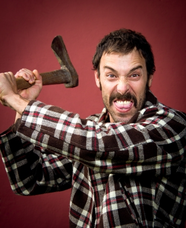 hatchet man: portrait of a woodcutter attackin with his ax Stock Photo
