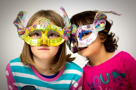 portrait of two little girls with mask photo