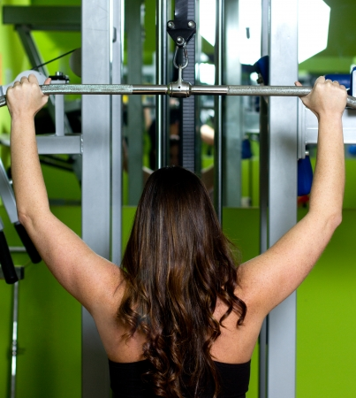 woman doing exercise in a gym Stock Photo