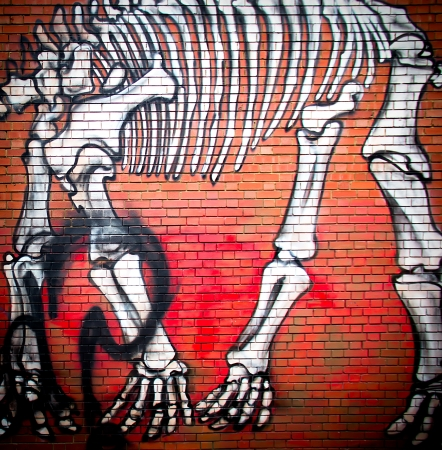 asbo: London, October 2013 - urban graffiti near Phipp Street. The work is a drawing of a dinosaur skeleton by an unknown artist