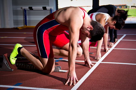 Athletes on sprint start training