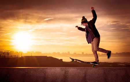 young teenager with a longboard photo