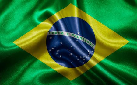 波とブラジルの旗布 写真素材