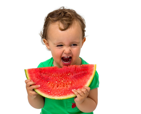 Baby eating watermelon isolated on white photo