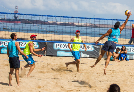 GIJON, SPAIN - JUL Jul 2014: Participants in the Voley Playa Tour 2014 Open Villa de Gijón , Spain, on Sunday, Jul 13, 2014.