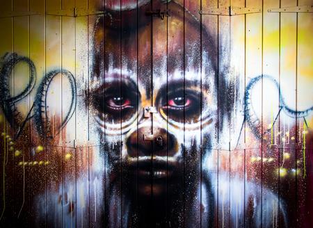 asbo: London, June 2014 - urban graffiti near Camden Lock Market. The work is a drawing portrait of man by an unknown artist