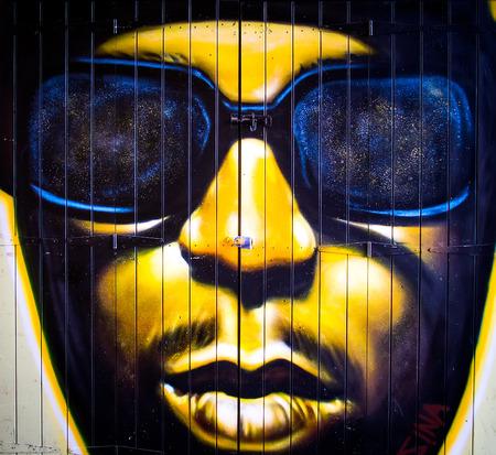 London, June 2014 - urban graffiti near Camden Lock Market. The work is a drawing portrait of man by an unknown artist