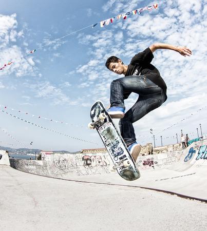 GIJON, SPAIN  Sep 2014:  Teenage skateboarders training in a skatepark of Gijón. Spain. September 11, 2014