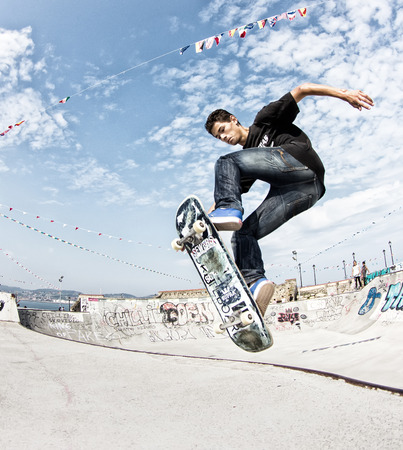 GIJON, SPAIN  Sep 2014:  Teenage skateboarders training in a skatepark of Gijón. Spain. September 11, 2014