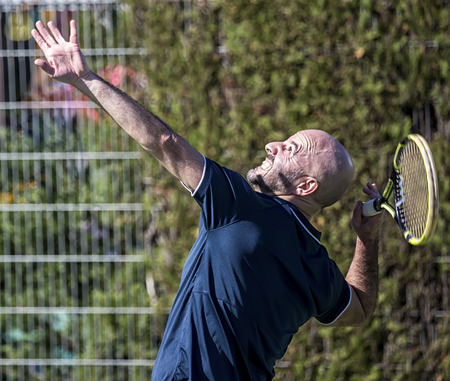 striving: Tennis player striving in a match
