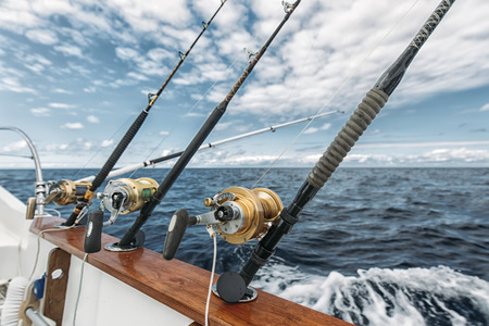 trolling: Fishing rods on a tuna fishing boat Stock Photo