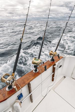 Fishing rods on a tuna fishing boat Stock Photo