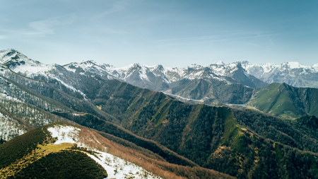 Aerial view of mountains and snowy peaks in Asturias, northern Spain
