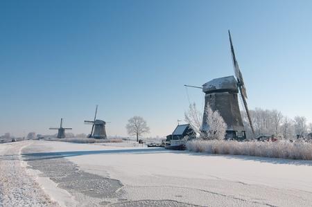 dutch windmill in  snow in clear blue sky Stock Photo - 12336480