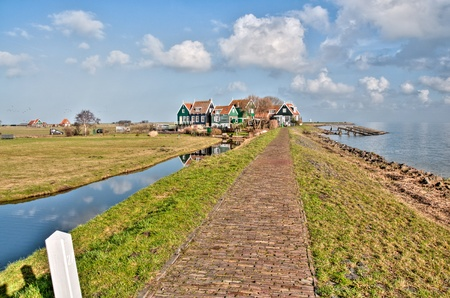 old village behind the dike Stock Photo - 12677214