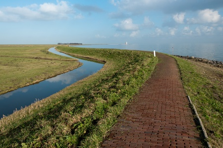 dike leading towards the lighthouse