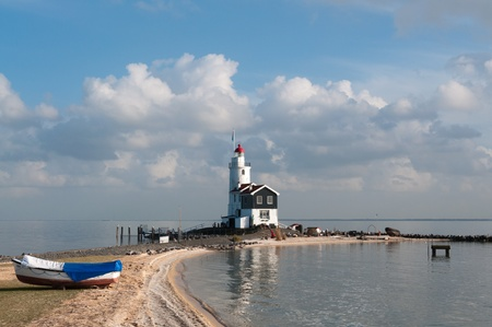 lighthouse withboat