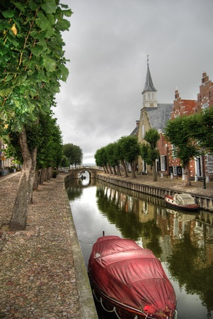 canal in old village sloten in Holland on rainy day