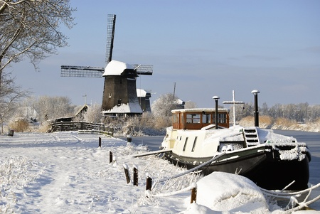 boat and windmill in the winter