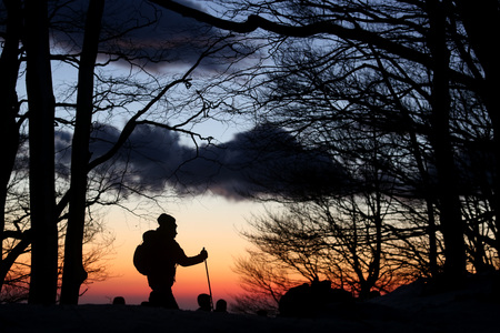 excursions: hiker walks at sunset along mountain paths Stock Photo