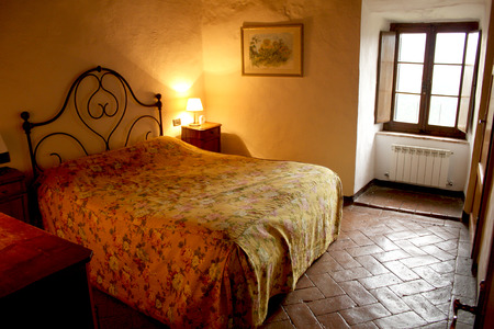 house with style: Tuscany rustic bedroom interior in Castello di Tocchi Italy Editorial
