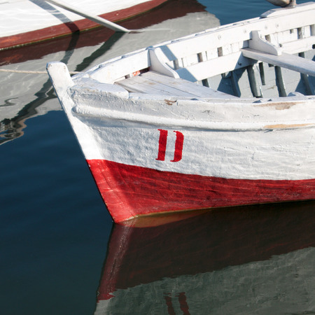reflection water: White Red Boat with water reflection