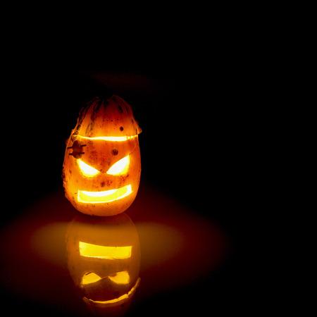 illuminated: Carved Pumpkins illuminated at night