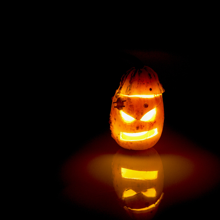 carved: Carved Pumpkins illuminated at night
