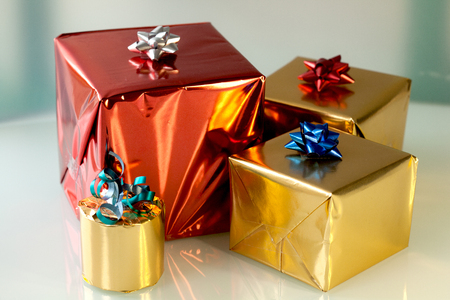 shiny gold: Christmas shiny wrapped boxes in gold and red
