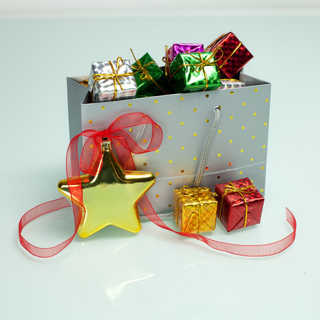 christmas shopping bag: christmas shopping bag full of boxes Stock Photo