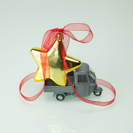consignment: Christmas is coming with a star on a truck