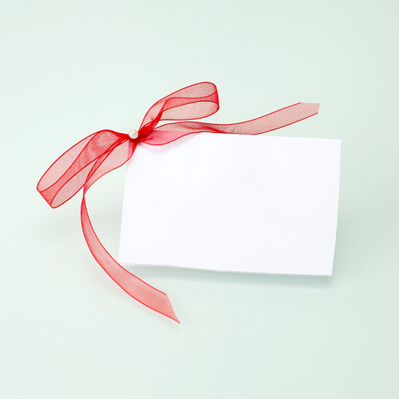 blank tag: invitation with ribbon on a white background Stock Photo