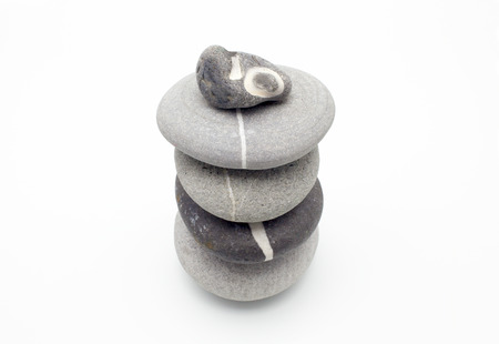 poised: group of poised stones on white