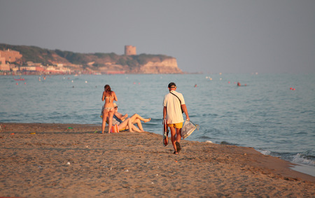 lazio: LAVINIO, ITALY - July 2010: unidentified people gets away in the twilight from the beach, Lavinio 2010.