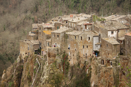 etrurian: Calcata, Italy - February 28, 2010: panoramical view of Calcatas town, unidentified people visiting alleys and little houses. Editorial