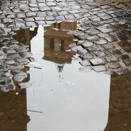 reflection: Trastevere Districts Church in puddle reflection