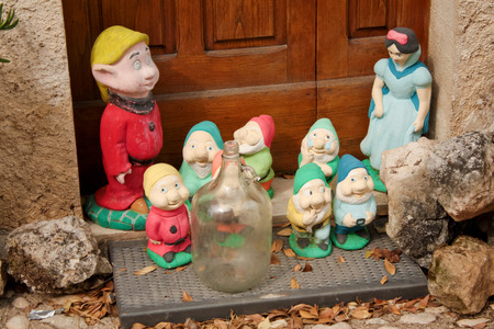 snow white and the seven dwarf statue door stock photo picture and