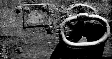 ring tones: Old wooden door handle outside view