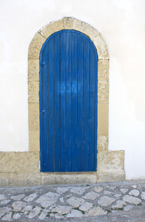 architectural architectonic: Door with arch southern italy Stock Photo