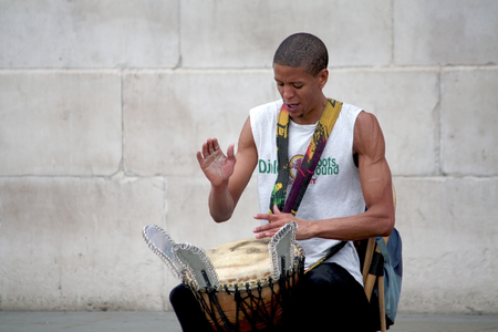 bongo drum: unidentified young man plays his bongo in the street of London.